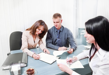 bank manager: People signing contract in  office