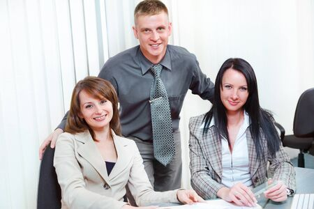 Three young managers in the office Stock Photo - 10803754