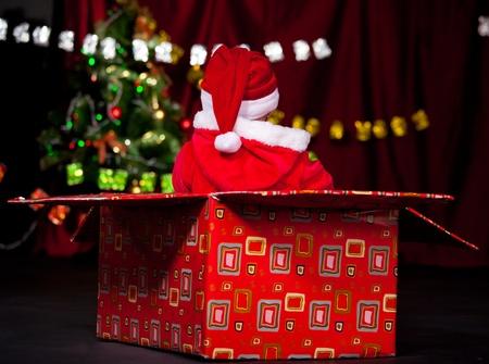 Little Santa helper in large present box photo