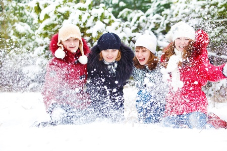 Teenage girls playing with snow in park photo