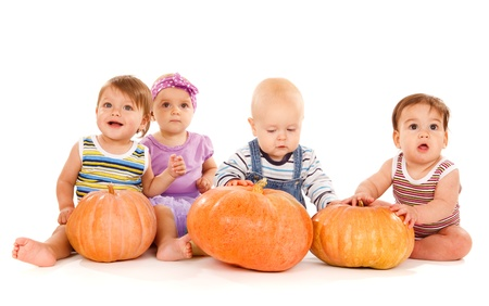 Group of lovely babies with ripe pumpkins, isolated Stock Photo - 10980939