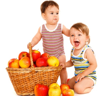 Two sweet toddlers and a fruit basket photo