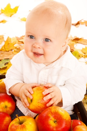 Portrait of a baby with apples photo