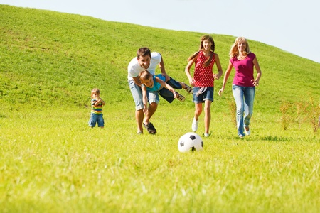 Excited parents with kids running photo