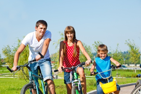 Father and kids riding bicycles Stock Photo - 10981012