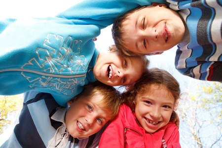 friend hug: Lovely embracing kids group in the outdoor