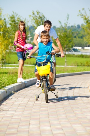Boy with father riding bicycles Stock Photo - 10981016