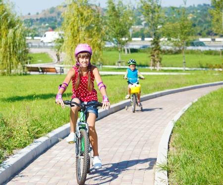Teenage girl riding a bike photo