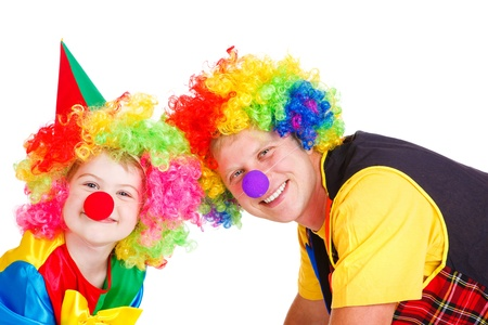 Little and adult clowns in colorful wigs, isolated photo