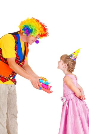 Cheerful clown giving little girl her birthday presents photo