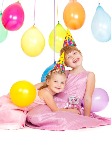 Lovely girls in party hats, embracing Stock Photo - 11056986