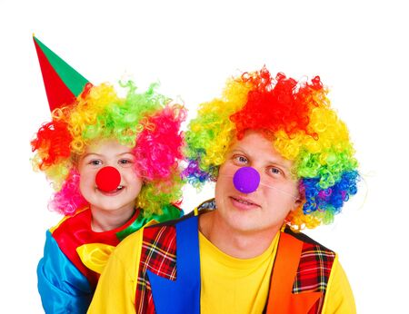 Clowns in colorful wigs, isolated photo