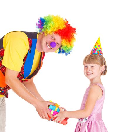 Clown presenting gifts to a little girl, isolated photo
