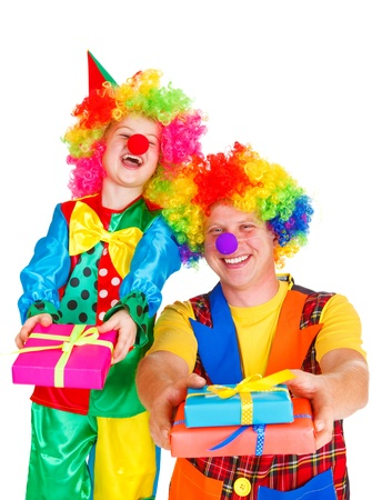 Two laughing clowns with birthday presents, isolated photo
