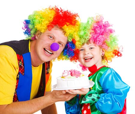 Two clowns holding birthday cake, isolated photo
