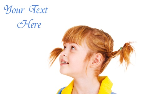elementary age girls: Portrait of a funny red haired little girl looking up Stock Photo