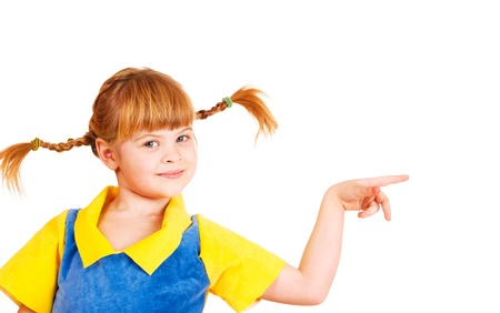 Cute little girl with funny braids pointing to the right photo