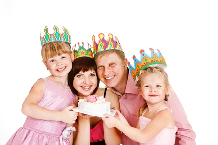 Parents and daughters in party crowns holding birthday cake photo