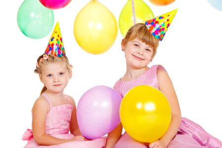 Cheerful kids with colorful birthday balloons photo