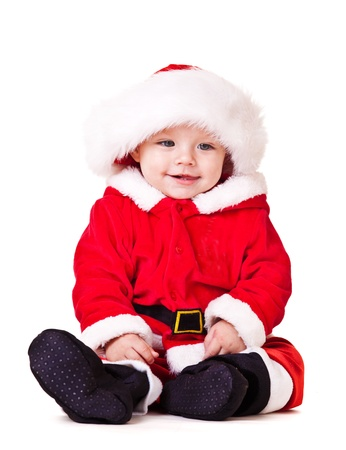 baby kerst: Zoete baby in rode kerst kostuum en hoed van de Kerstman