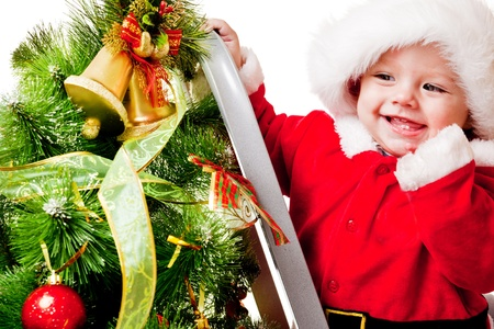 step ladder: Christmas baby on the step ladder Stock Photo
