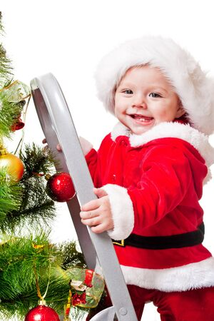 Laughing toddler on step ladder, decorating Christmas tree Stock Photo - 11133930