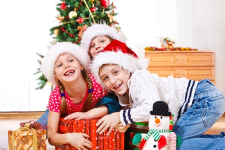 family fight: Kids in Santa hats fighting for presents