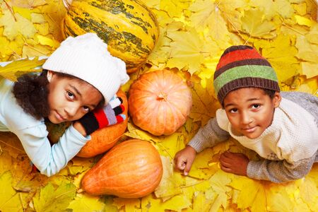 African american brother and sister with autumnal harvest photo