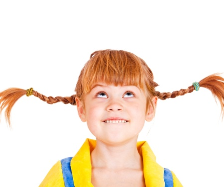 little girl smiling: Portrait of a funny red haired girl looking up Stock Photo