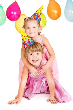 Kids in party hats playing photo