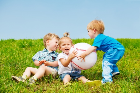 Angry toddlers fighting for the ball Stock Photo