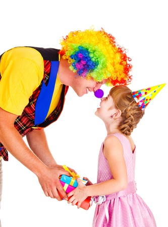 Funny clown giving present to a little girl photo