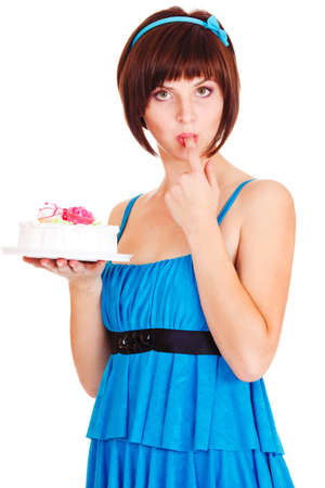 Young woman tasting a cake, over white photo