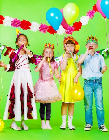 children party: Children group with birthday blow outs