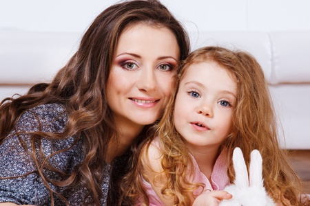 Beautiful mother and little daughter photo