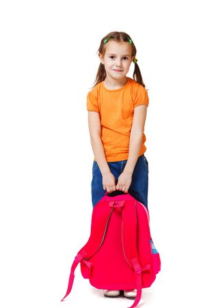 Smiling kid holding backpack, isolated