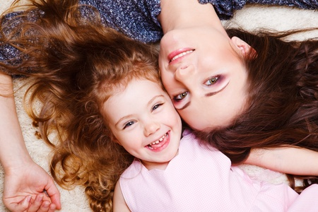 Laughing curly little girl and her mother Stock Photo - 11205270