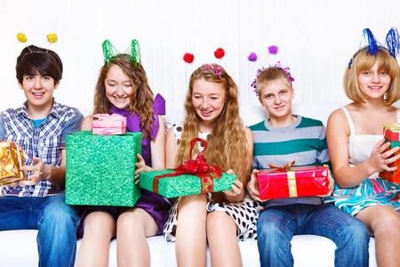 Happy teenage friends with presents photo