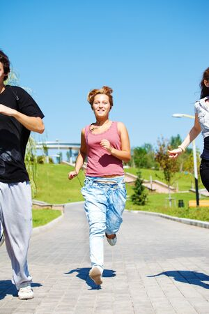 Young people jogging in the city park photo