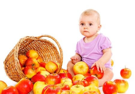 Baby sits beside fruit photo