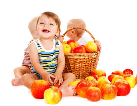 Laughing baby boy and his friends sit around apples Stock Photo - 11398310