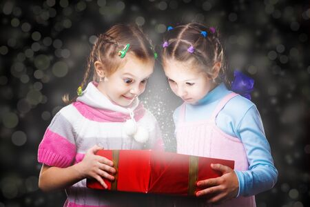 Two girls holding magic box photo