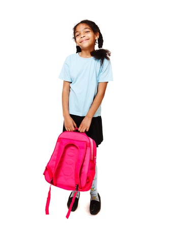 seven years: Joyful little girl with a backpack