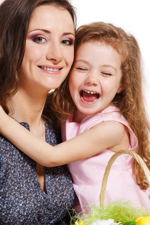 Laughing preschool girl embracing mother photo