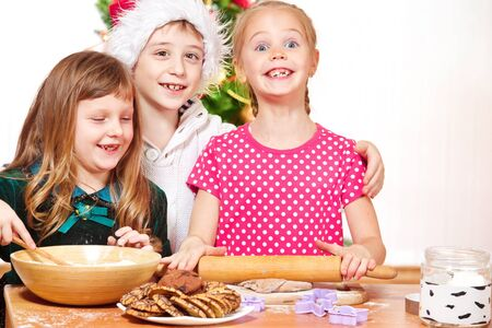 Attractive kids cooking photo