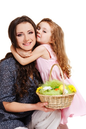 Laughing mother holding easter basket, daughter embracing her Stock Photo - 11398327