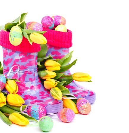 rain boots: Rain boots full with Bright Easter eggs and yellow flowers around