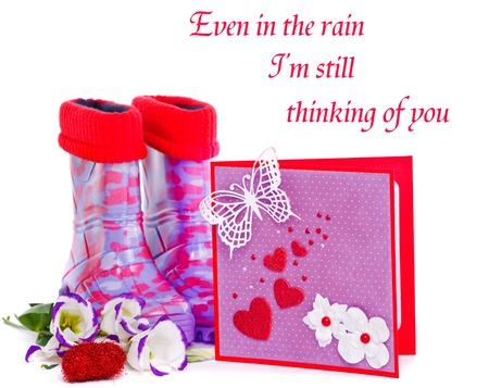 Rubber boots and a valentine greeting card photo