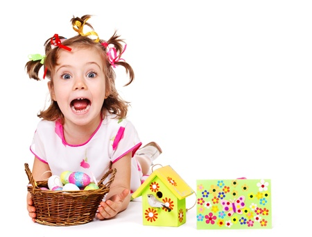 girl open mouth: Funny little girl holding wicker basket with Easter eggs Stock Photo