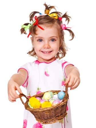 Attractive kid holding spring basket with Easter eggs photo